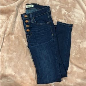 9in high rise button front jeans